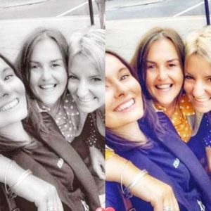 A collage of four identical pictures in both colour and monochrome show three female colleagues with arms around each other in an affectionate embrace. They are smiling to camera