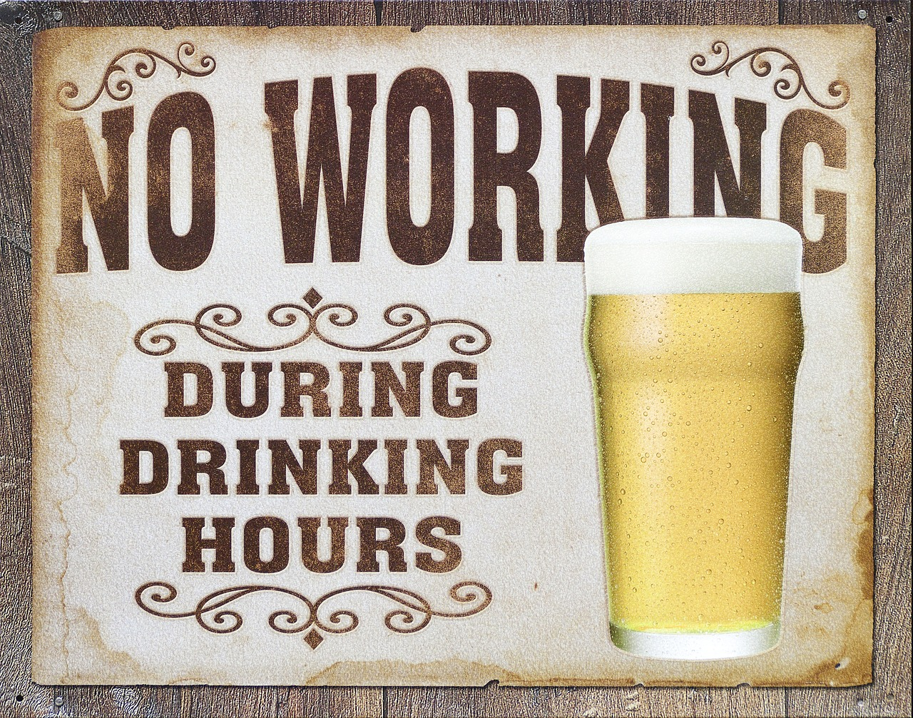 "Old-fashion style advert depicting a pint of beer and the slogan, ""No Working During Drinking Hours."" It is used to mock free beer Fridays that happen to prove the existence of workplace culture"